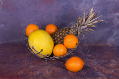 Still life with fruit. Citrus, melon, pineapple royalty free stock images