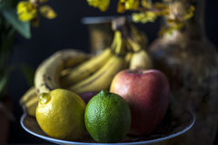 Still life with fruit and flowers Stock Photos