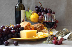 Still life with fruit and a glass of wine. Stock Images