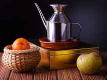 Still life with fruit and a jug of oil Stock Photo