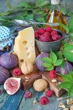 Still life with fruit, nuts and cheese Stock Image