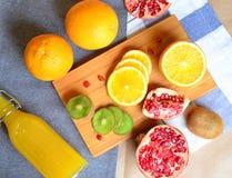 Still life of fruit. Pomegranate, orange and kiwi Stock Photos