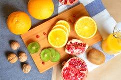 Still life of fruit. Pomegranate, orange and kiwi Stock Photography