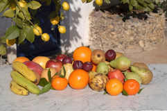 Still life of fruit with sunlight outside, Stock Image