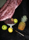 Still Life. Fruit in vase and knife in still life stock photography