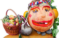 Still life of fruit and vegetables. Pumpkin in the form a woman's head. Stock Photos