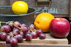 Still life of fruit on vintage wood background Royalty Free Stock Image