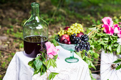 Still life of fruit, wine. Still life of fruit and red wine on a table with white tablecloth Stock Photos