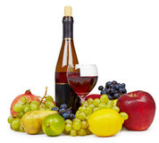 Still life of fruit and wine on white Stock Photos
