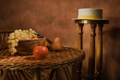 Still-life with fruit in a wooden dish Stock Photos