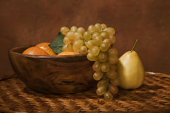 Still-life with fruit in a wooden dish Royalty Free Stock Image