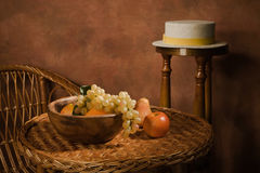 Still-life with fruit in a wooden dish Royalty Free Stock Images