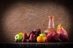Still life fruit on the wooden table Royalty Free Stock Image