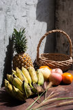 Still life with Fruits and a basket Stock Images