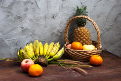 Still life with Fruits and a basket Royalty Free Stock Photos