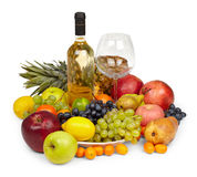 Still Life - fruits and bottle of white wine. Still Life from a heap of fruits and bottle of white wine isolated on white background Royalty Free Stock Images