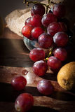 Still life Fruits with Chinese pear,kiwi,Red apple,grapes and Cu. Ltivated Banana on the wooden table Stock Image