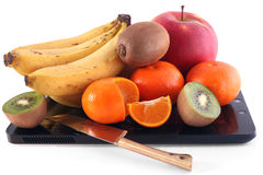 Still life: fruits and knife. Fruits and knife lies on a surface of the touch screen Stock Photography