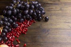 Still life fruits, pomegranates, grapes. Top view. royalty free stock photos