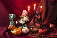 Still life of fruits and vegetable on the table and candle stand Royalty Free Stock Photos