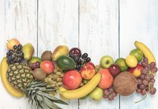 Still life fruits on wooden background. Healthy fruit background ; Studio photo of different fruits on white and  blue  vintage wooden table , high resolution Royalty Free Stock Photo