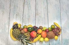 Still life fruits on wooden background. Healthy fruit background ; Studio photo of different fruits on white and  blue  vintage wooden table , high resolution Stock Photography