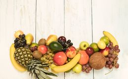 Still life fruits on wooden background. Healthy fruit background ; Studio photo of different fruits on white and  blue  vintage wooden table , high resolution Stock Image