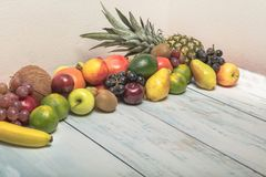 Still life fruits on wooden background. Healthy fruit background ; Studio photo of different fruits on white and  blue  vintage wooden table , high resolution Royalty Free Stock Image