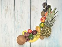 Still life fruits on wooden background. Healthy fruit background ; Studio photo of different fruits on white and  blue  vintage wooden table , high resolution Royalty Free Stock Photography