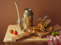Still life with fusilli pasta and tomatoes Stock Photo