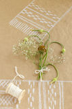 Still life with garlic, buds, flowers and spool of twine Stock Photography