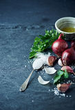 Still life with garlic, onion, parsley and sea salt Stock Photo