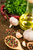 Still life with garlic, vegetable oil and spices Stock Photo