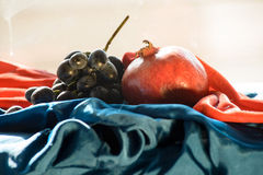 Still Life Garnet And Grapes. In Clothes. Sun Light Stock Images