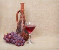 Still-life from Georgian jug and fruit Stock Photos