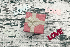 Still life of gift box on grunge wood background Royalty Free Stock Images