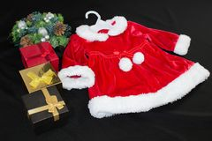 Still life, gift boxes and santa costume on a black background. stock images