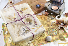 Still life with gift and hand drawn pirate map Stock Photography