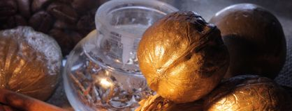 Still-life with a gilded nut Stock Image