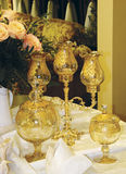 Still life with gilt goblets. And candlesticks Stock Photos