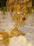 Still life with gilt goblets. And candlesticks royalty free stock image