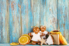Still life of gingerbread, gingerbread men, dried oranges on blue wooden background, Christmas or New Year background. Greeting card template Royalty Free Stock Photos