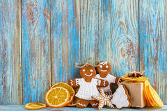 Still life of gingerbread, gingerbread men, dried oranges on blue wooden background, Christmas or New Year background. Greeting card template Stock Images