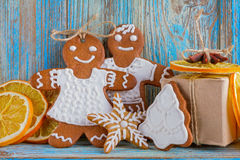 Still life of gingerbread, gingerbread men, dried oranges on blue wooden background, Christmas or New Year background. Greeting card template Stock Photo