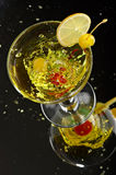 Still life with glass. With drink on the black background Royalty Free Stock Image
