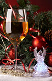 Still life with glass and angel. In front of fir tree stock photos