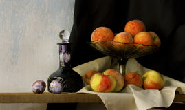 Still life with glass, apples, peaches. And plums in holland classic style Royalty Free Stock Photos