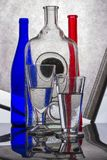Still life with glass bottles and glasses. With reflection royalty free stock image