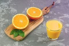 Still Life Glass of Fresh Orange Juice on concrete background with filter. Royalty Free Stock Image