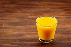 Still Life Glass of Fresh Orange Juice on Vintage Wood Table with Copy Space Background Stock Images